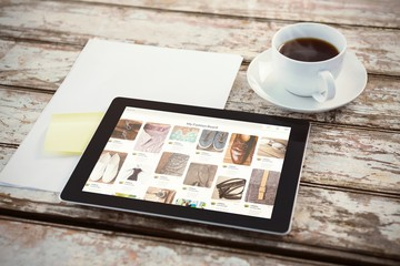 Composite image of overhead of tablet on desk