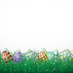 Easter eggs with mesh in grass on a white shining background with flowers