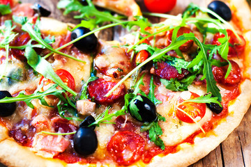 Fresh baked pepperoni pizza close up on wooden table, shallow depth of field,