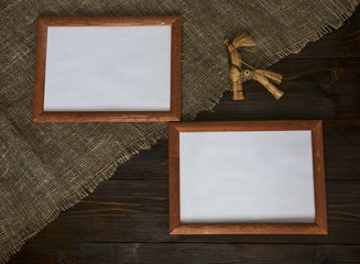 Two frames on wooden background with a toy.