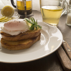 Breakfast. a poached egg with toast