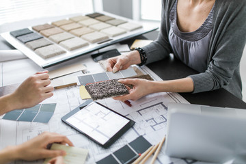 An interior designer consults with clients