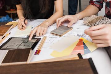 An interior designer reviews renovation plan with client