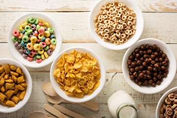 Variety of cold cereals in white bowls