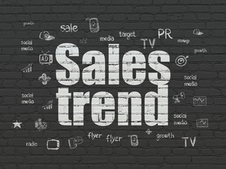 Advertising concept: Sales Trend on wall background