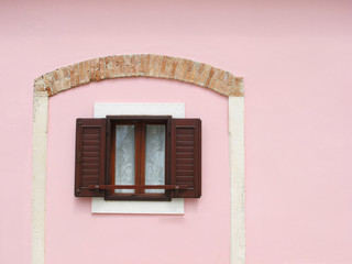 wooden window isolated on a pink wall