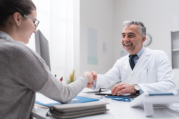 Doctor and patient shaking hands