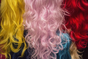 Rainbow of female long wavy hair. Art object of hairdressing.