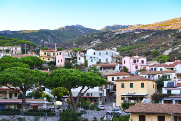 Small village with colourful houses on seaside of Elba island, Italy