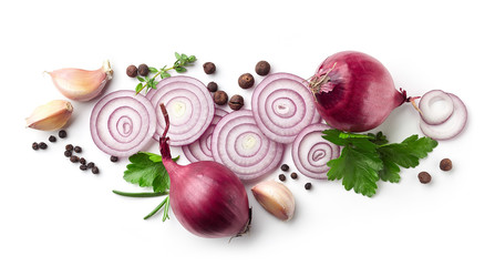 red onions, garlic and various spices on white background