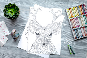 coloring picture for adults on wooden background top view