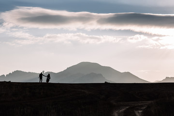 silhouette of couple on the background of the beautiful mountains of the mountains.