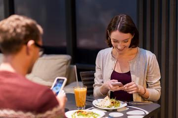 happy couple having dinner at vegan restaurant