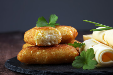 Homemade potato croquettes with parmesan and chives, nice and simple, but delicious light food