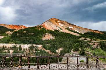 abandoned Yankee Girl mine in Colorado with storm clouds