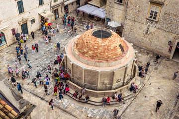Many tourists visit the Old City of Dubrovnik and the famous Onofrio Fountain