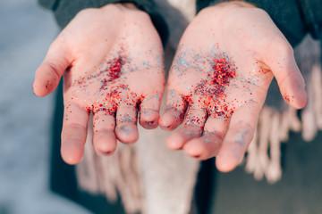 Woman holding glitter