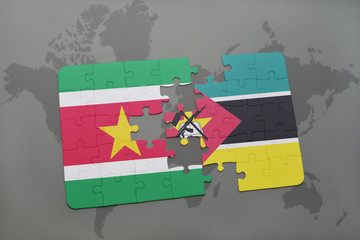 puzzle with the national flag of suriname and mozambique on a world map