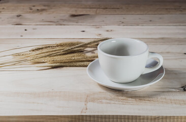 Empty coffee cup on wood background