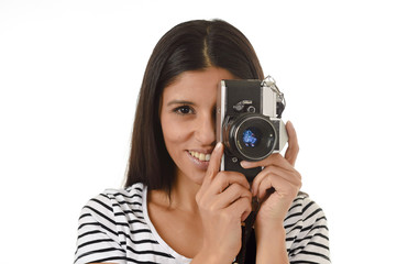 latin woman taking pictures looking through the viewfinder of an old cool retro vintage photo camera