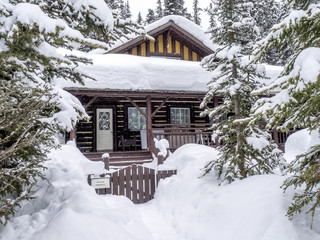 snow covered cabin in the Rocky Mountains at Lake Louise in Alberta Canada