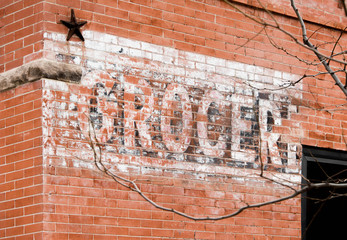Grocer Sign on Brick Wall