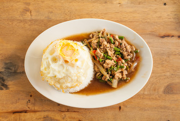 Rice topped with stir-fried pork and basil and Fried egg