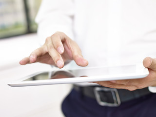 closeup of hand of a business person using a tablet