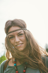 Smiling girl in hippie style