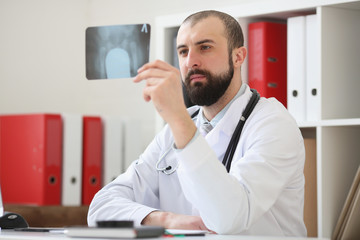 Doctor watching x-ray of patient