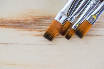 Art background. Brushes for painting on wooden canvas.