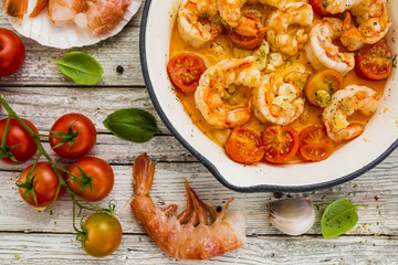 Fried shrimp with tomatoes and garlic. Mediterranean and Italian food.