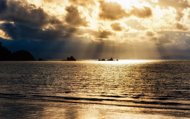 Bright sun light, rays of light shine in water, sunbeam in cloudy sky, summer ocean view,KOH PHAYAM ISLAND, RANONG, THAILAND