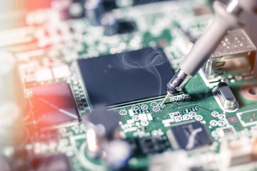 Electronic background: soldering of computer motherboard