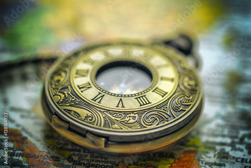 Vintage pocket watch on old fashioned world map background stock vintage pocket watch on old fashioned world map background gumiabroncs Gallery