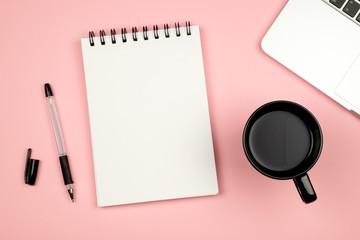 Minimal flat lay style picture of blank notebook page with different objects
