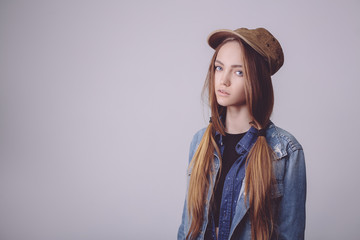 Closeup fashion studio portrait of hipster young tender girl