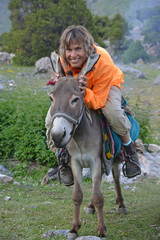 Happy woman on donkey