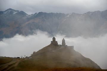 Gergeti Trinity Church in clouds