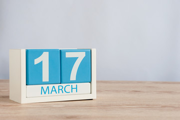 Happy St Patricks Days save the date. March 17th. Day 17 of month, wooden color calendar on table background. Spring time, empty space for text