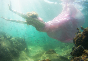 Woman floats underwater