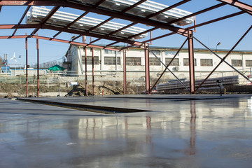 Fresh polished concrete slab and metal construction