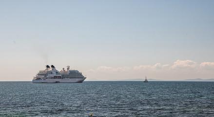 A pilot boat leads a cruise ship along the fairway. Bulgaria.