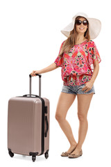 Female tourist with a suitcase