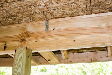 roof rafter and ceiling joist with blue sky background