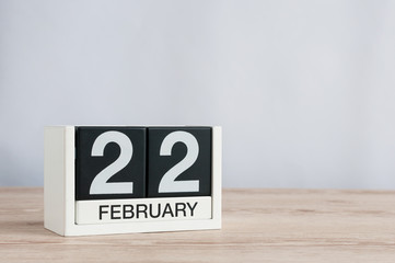 February 22nd. Day 22 of month, everyday calendar on wooden table background. Winter concept. Empty space for text