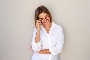 business woman smiling and holding glasses