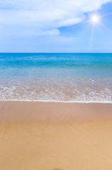 white soft wave on empty tropical beach and blue sea