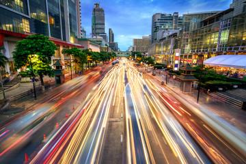 Busy street at dusk, full of car light streaks Wall mural