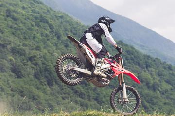 Fototapete - atterraggio con moto da cross